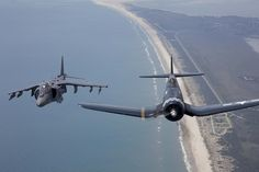 A Marine Corps AV-8B Harrier and vintage F4U Corsair fly side by side over the 2012 Marine Corps Air Station Cherry Point Air Show.