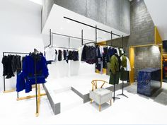 Sacai store reflects its urban surroundings via Frameweb.com
