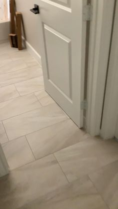 Installation of porcelain tile on entire floor with spacer. We use CQ grout from mapei products. Call the tile professional Houston Tile Works. over 35 years on this trade Hallway Flooring, Living Room Flooring, Kitchen Flooring, Floor Tiles For Kitchen, Home Flooring, Light Wood Flooring, Modern Floor Tiles, Laminate Tile Flooring, Modern Wood Floors
