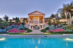 Palladian Palace $5,850,000   Thanks to lavish landscaping, arresting architecture, and perfect pools — like you in your favorite pair of jeans, these homes look good from the back. First up is an enchanting European-style estate in Santa Barbra, CA, where classic style meets modern amenities to create an outdoor area that will hold your gaze for days.