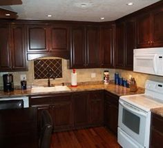Rich Mahogany Cabinets...pricing, Etc. Maybe This Color For The Cabinets  With Black Appliances And The Cherry Hardwood Floors.