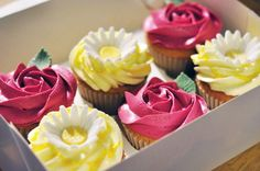Lemon Daisy and Raspberry Rose cupcakes by Juniper Cakery