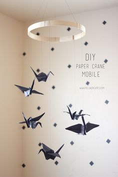 Paper crane mobile…But a huge one with stars and sparkles. use hula hoop