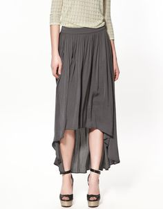 The asymmetry on this grey skirt is a cool look, especially with the wedge sandals