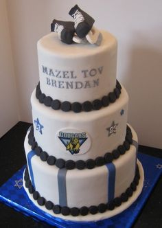 I made this cake for my nephew's Bar Mitzvah. It's a fondant covered chocolate cake filled with chocolate SMBC. The skates, hockey-puck border, and appliques are gumpaste, and the logo is an edible image. Bar Mitzvah Decorations, Bar Mitzvah Centerpieces, Bar Mitzvah Themes, Bat Mitzvah, Centrepieces, Hockey Birthday Parties, Birthday Ideas, Hockey Wedding, Hockey Cakes