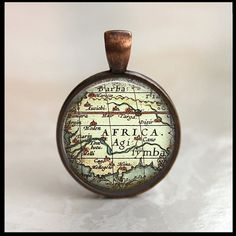 Glass Tile Necklace Jewelry Bronze Bezel Africa Map Pendant Free Shipping. $12.00, via Etsy.