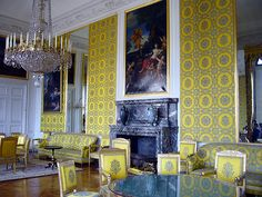 Another view of the family room showing the calming effect of using yellow silk brocade fabric throughout.