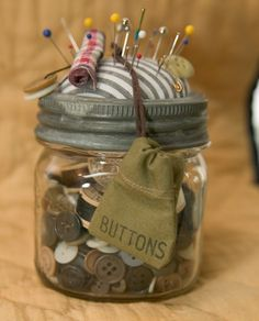 Sewing kit inside an old canning jar. and the jar would be fun to decorate too :)