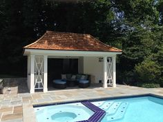 We built this custom pool house with a shower, changing room, storage and a flagstone patio in McLean, VA