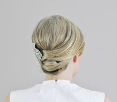 How to Do the Wrapped Updo: Far more interesting than a simple bun but not much harder to create, this crisscrossed and twisted 'do looks chic and modern -- an easy DIY wedding hairstyle.