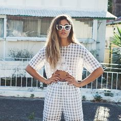 Mimi Elashiry in a checked white co-ordinated outfit with sheer crop top | Fashiolista.com
