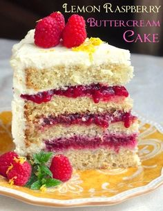 Raspberry Lemon Buttercream Cake -  An old fashioned lemon scratch cake gets filled with layers of Raspberry compote before being enveloped in tangy, sweet lemon buttercream frosting.