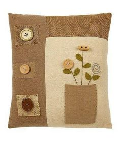 This pretty pillow effortlessly adds an element of spring cheer to chairs and sofas. Cute Pillows, Diy Pillows, Decorative Pillows, Throw Pillows, Burlap Flowers, Pillow Fight, Sewing Pillows, Quilted Pillow, Wool Applique