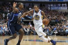 Golden State Warriors forward Kevin Durant (35) drives against Dallas Mavericks forward Harrison Barnes (40) during the first half of an NBA basketball game in Dallas, Wednesday, Jan. 3, 2018. (AP Photo/LM Otero)