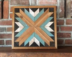 Southwest Star wall quilt is handmade from reclaimed rough-cut western red cedar and measures 18 x 18. The salvaged cedar boards are 50 years old and have a beautiful patina and texture. The striking pattern comes to life in stained kona brown, vintage teal, antique white, and