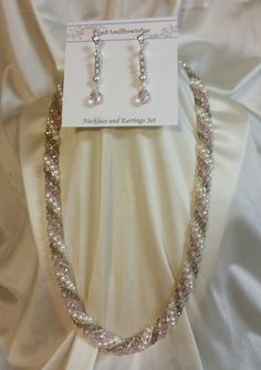 At  Etsy pearls-and-crystals-necklace-and-earrings-set $24.00
