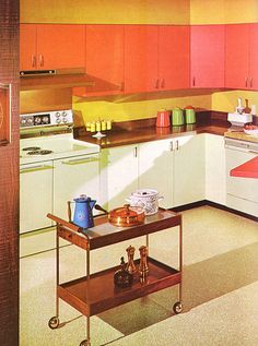 Awesome orange 1970's kitchen, my fave! Copper is a nice touch