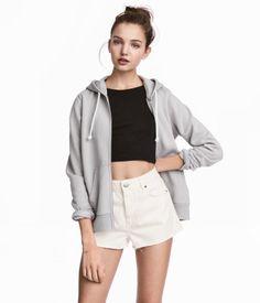 Dark gray melange. Sweatshirt jacket with a lined drawstring hood, zip at front, side pockets, and ribbing at cuffs and hem. Soft, brushed inside.