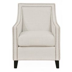 We love the nailhead trim on this upholstered chair. | $105