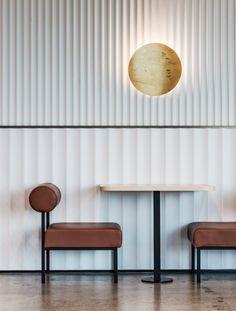 Fluted Architectural Detailing on Kitchen Islands and Wall Paneling Cafe Design, Küchen Design, Design Firms, Bar Bistro, Interior Walls, Interior Design, Estilo Interior, Architectural Columns, Wall Cladding