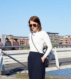White turtleneck from Gina Tricot and navy culottes from ASOS.
