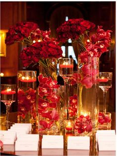 Would love to have flowers submerged in the vase, a bouquet on top and floating candles. Prefer softer colors