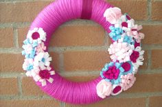 Wreath. Pink yarn wreath decorated with multicolored  by MoCactus, €24.00