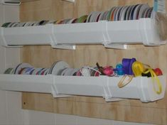 maybe i could do rain gutter ribbon storage? guess i'll have to see what size most of my spools are...
