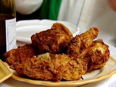 Oven-Fried Chicken : Ina's fried chicken trick is to fry it quickly, so it's crispy on the outside, and then finish cooking it in the oven, so it's tender and juicy on the inside.