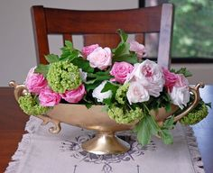 This gold aluminum trophy shaped bowl makes a stunning centerpiece container!