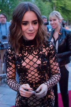 Lily Collins. I love this but I can't decide if there is a lining on that dress...