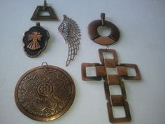 cross and large round amulet