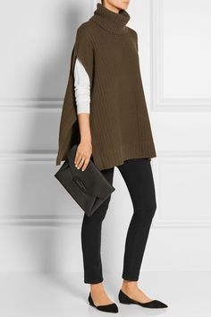 Theory (poncho). Stella McCartney (sweater). Frame Denim (jeans). Givenchy (clutch). Jimmy Choo (flats).