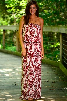 This elegant affair of a maxi dress features a totally chic damask print in a rich red that is a little romantic and a little sassy! The strapless fit is truly flawless and the cool material makes this one a great transition pieces for the summer to fall season!
