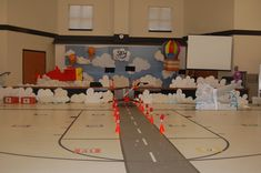 A airplane runway out of a roll of gray table cloth and white duct tape! 2 cups on cones for lights. Group's SKY VBS decorations