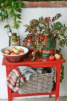 Table for Autumn... I love the way it could carry straight through to Christmas, AND the way she incorporates her warm sweaters into the decor! Could do this with a nice pile of thrifted shawls!