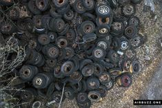 A pile of old tires, drone style.  The remote Swedish scrapyard where old cars rust in peace! Photographed with a drone. https://airbuzz.one/drone-pictures-of-bastnas-car-cemetery/ #dronephoto #droneblogg #djiblogg #djimavicpro #dji #carcemetery #sweden #carwrecks #oldcars #rustycars #cars #sweden #bilskroten #båstnäs #dronephotography #wheels #alloys