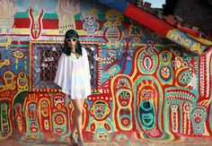 A rainbow dress and top! Travel TV host La Carmina models for a magazine with a male model, at Taichung Rainbow Village in Taiwan. Learn about these strange painted houses at >>> http://www.lacarmina.com/blog/2015/01/rainbow-village-taichung-taiwan-art/  台中彩虹眷村