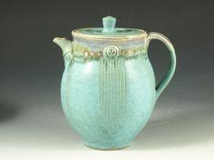 hawk  Teapot, turquoise glaze