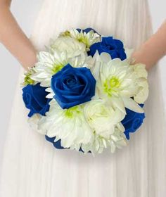 Roses & Mums Bouquets-	A bridal bouquet of white pompons and deep blue roses.