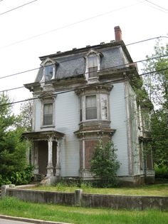 Abandoned Victorian town house. Court St. Farmington, Maine