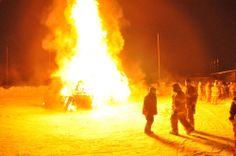 Firefighters light the bonfire at the Sunrise Festival.
