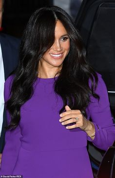 Meghan Markle recycles a £107 purple gown and removes eternity ring for London event | Daily Mail Online
