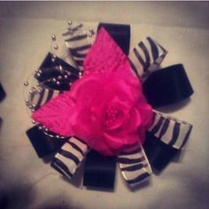 Pink black and zebra corsage