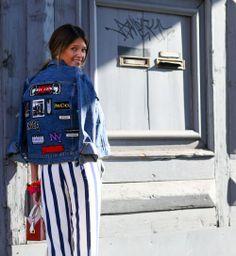 Une veste en jean à écussons, beau look de la Fashion Week automne hiver 2014-2015 - Cosmopolitan.fr