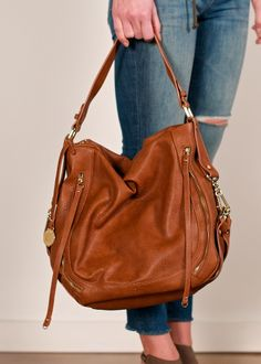Urban Expressions Jessie hobo; tan vegan leather hobo bag, pebbled faux leather handbag, tan faux leather handbag featuring polished gold tone hardware & exterior zippered compartments on front & bag, hobo handbag with a wide top handle & long cross body, the perfect hobo bag for everyday wear
