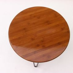 This is a terrible picture - but the guy makes them with mid-centry modern hairpin legs (just follow the link) Again, color is not right but maybe he can make them with walnut tops