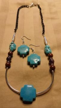 Turquoise Cross Necklace & Earrings Set  Beautiful turquoise (howlite) cross accented with silver spacers, and finished with poppy jasper, amethsyt, free form turquoise & hematite. Ends with a black metal chain, and a silver lobster claw clasp. Nec...