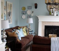 A tour of our living room painted with Benjamin Moore Woodland Blue and accented with brown and chartreuse green.