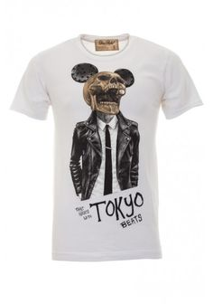 "Dom Rebel | 'Tokyo' T-Shirt White | Short sleeve crew neck t-shirt features hand-drawn artwork of a skull with oversize ears in a biker jacket and shirt & tie, with ""Fast Nights With Tokyo Beats"" at bottom. Detailed with 25 hand-set black Jet Swarovski crystals on ears, each crystal being hand-mounted to a metal setting on the inside of shirt. Vintage washed with raw edge sleeves and distressed neck."